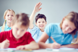 Clever schoolboy raising his hand at lesson bespoke languages tuition (blt) Flat 3, 18 Cavendish Road