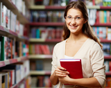 Portrait of clever student with book in college library bespoke languages tuition (blt) Flat 3, 18 Cavendish Road