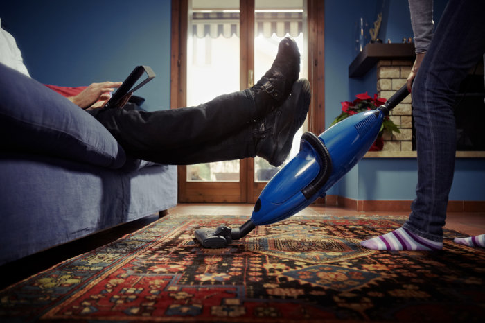 caucasian heterosexual couple, with woman doing chores using vacuum cleaner on carpet and lazy man on sofa with tablet pc. Horizontal shape, low angle view Profile Photos of Belvedere Carpet Cleaners 26 Nuxley Rd - Photo 5 of 9