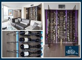 Custom Wine Cellar with Smoked Glass Doors and Chrome Wine Pegs