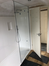 Shower screen fitted at loft conversion in Sussex.