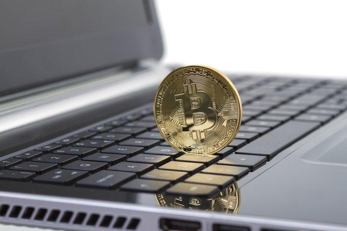 Studio shot of golden Bitcoin virtual currency on laptop. Close-up of front side.  Profile Photos of Randall Crater 255 Primera Blvd, Suite 160 - Photo 2 of 3
