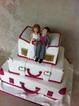 Stacked suitcases with handmade bride and groom from £410 Sharon Lord Cakes Fiddlers Field Croydon Road