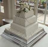 Square cake with quilted side pattern and sugar roses from £385 Sharon Lord Cakes Fiddlers Field Croydon Road