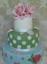 3 tier vintage style with hand painted bottom tier and large sugar rose from £385