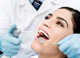 A close-up shot of a patient getting a inspection from a dentist<br />
