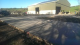 Log & hay & straw drying barn, with Solar PV roof & part 1 of the resurfaced yard.