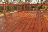 Photo of wooden deck with fresh stain. Image shows interesting angle of deck boards.