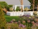 Experience tranquility and elegance in the colourful garden of the St. Regis Mardavall. The St. Regis Mardavall Mallorca Resort Passeig Calvia s/n