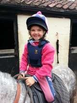 One very happy little customer......her first ride on her formerly un-rideable pony