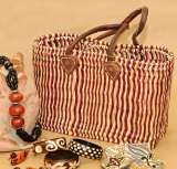 Grass bag with leather trimmins http://ow.ly/lUD1K  Free delivery only £14.75