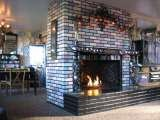 Our very wonderful mosaic fireplace upstairs.
