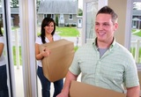 Young Attractive Couple Moving Into Their New Home