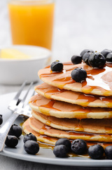 Delicious breakfast of pancakes with blueberries and orange juice, Best of the Brunch, London