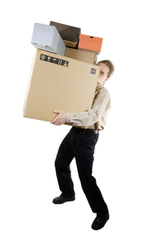 A man carring different size boxes