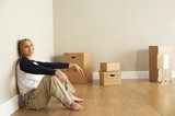 Young Woman Resting After Moving Into New Home