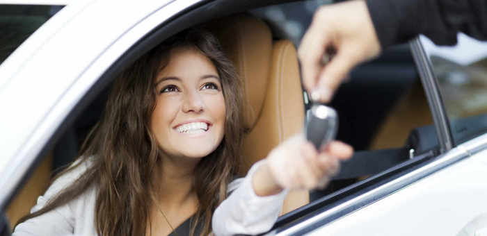 Young woman receiving the keys of her new car Profile Photos of EONS Auto Care Center 330 W Harden St - Photo 4 of 5