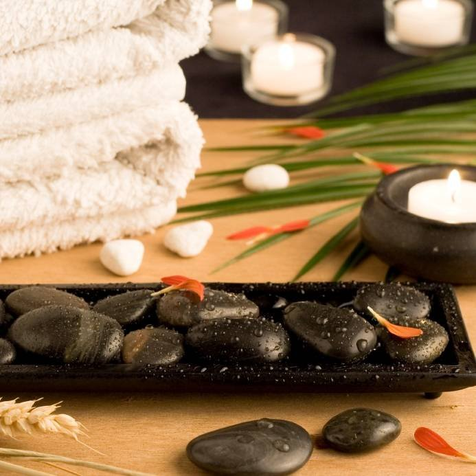 Spa setting with white towels, pebbles, candles and palm leaf Profile Photos of Acupuncture & Alternative Health Care Concepts,Inc. 10645 Riverside Drive - Photo 3 of 8