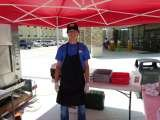 cooking sausage wraps for car dealership grand opening.