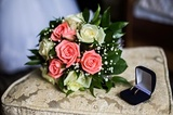 wedding rings on blue box wedding bands bouquet of pink and white roses the preparation for the wedding style wedding jewelry wedding preparation wedding gown