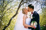 Kissing wedding couple in spring nature close-up portrait. Kissing wedding couple in spring nature close-up portrait outdoor in blooming spring garden. flowering trees wedding bride and groom in love