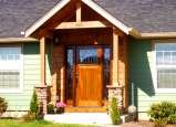 Craftsman style entry door with matching sidelites