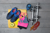 top view of colorful fitness equipment on wooden floor