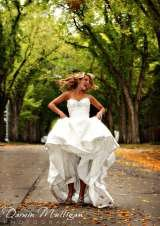 bride kicks up her dress as she walks down the path