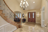 Foyer in luxury home with curved staircase Big Ben Cleaning Inc. 841 Canoe Green SW