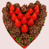 Dark Chocolate dipped fresh strawberries topped in caramel morsels and arranged in shape of a heart.