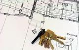 close up of blue prints with ring of keys
