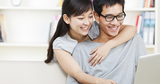 happy young couple using laptop at home, 12 Month Payday Loans, Slough