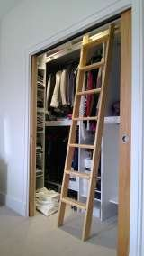 Fitted wardrobe with hanging rails and ladder