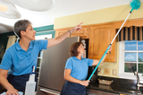 Two Cleaners Cleaning The Domestic Kitchen With Cleaning Equipment Chalcot House Services 17 Hanover Square