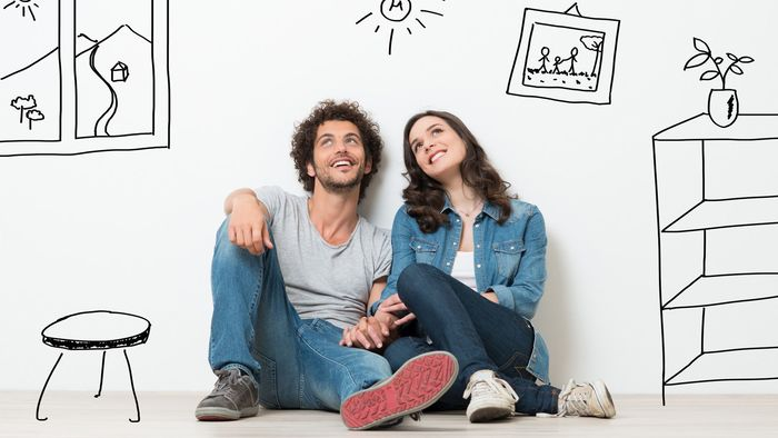 Portrait Of Happy Young Couple Sitting On Floor Looking Up While Dreaming Their New Home And Furnishing Profile Photos of iMortgageBroker Inc. - Dominion Lending Centres 415 Wharncliffe Rd S - Photo 7 of 7