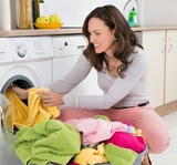 Young Woman Putting Clothes Into Washing Machine At Home, Palo Alto Appliance Repair Solutions, Palo Alto