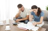 Worried couple doing their accounts in the living room at home, Auto Loan Bad Credit With Low Income, Dallas