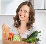 Happy Woman Holding Grocery Shopping Bag With Vegetables In Kitchen At Home, Richmond Appliance Repair Pros, Richmond