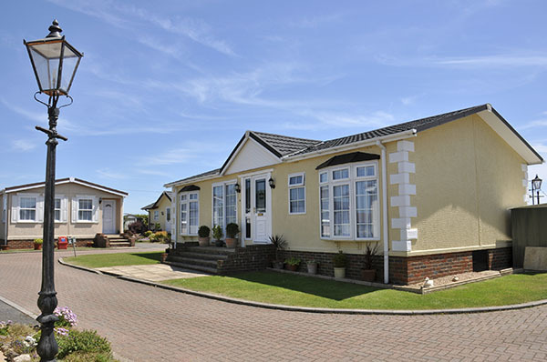 Residential mobile home park in South East England.  Generally this type of caravan park estate is for home owners over the age of fifty years. What We Do of Sandstone Home Loans 5155 S Durango Drive, Suite 102 - Photo 1 of 2