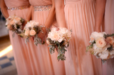 Bridesmaids holding beautiful bridal bouquets