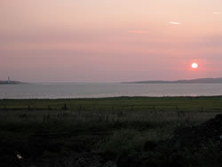 Sunset view over Stromness on Scapa Flow from Buxa 3 chalets sleeping 4 each in king and/or twin beds of Buxa Farm Chalets & Croft House A964 - Photo 5 of 16