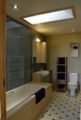 Roomy bathroom with shower over tub 3 chalets sleeping 4 each in king and/or twin beds of Buxa Farm Chalets & Croft House A964 - Photo 10 of 16