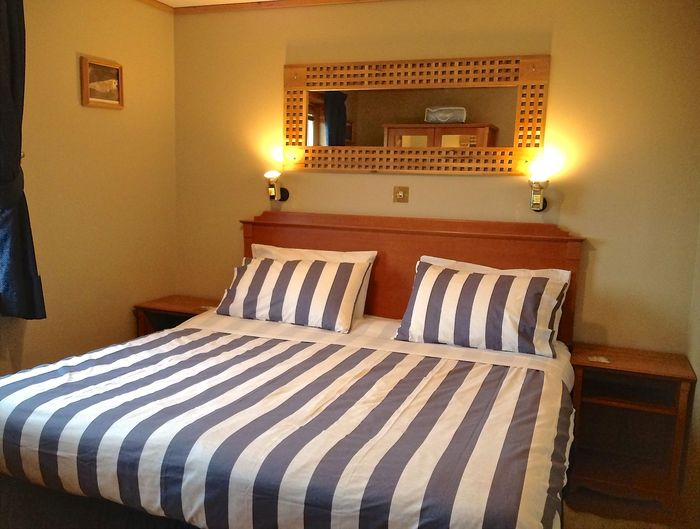 King size bed can be split into twins. 3 chalets sleeping 4 each in king and/or twin beds of Buxa Farm Chalets & Croft House A964 - Photo 12 of 16