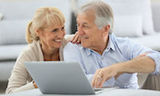 30239986 - senior couple websurfing on internet with laptop