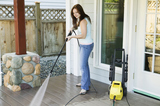 Side profile of a young woman cleaning the porch of her house, Harris Pressure Washing LLC, Tallahassee