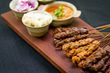 Satay Platter - marinated beef, mutton & chicken with Asian flavours, warm rice cake, cucumber & onion served with peanut sauce