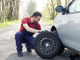 man fixing a car problem after vehicle breakdown on the road, Absolute Roadside Assistance And Car Door Unlocking, Colorado Springs,
