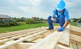 Roofer Carpenter Works on Roof Roofing KC 907 E 56 Highway