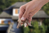 handing keys in the house background