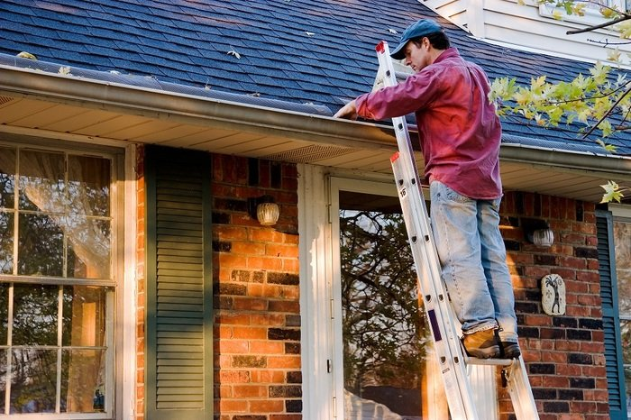 Man Cleaning Gutters on a Ladder Against a Brick House Profile Photos of Roof Gutter Cleaning Melbourne PO Box 481 East Melbourne VIC 3002 - Photo 1 of 4